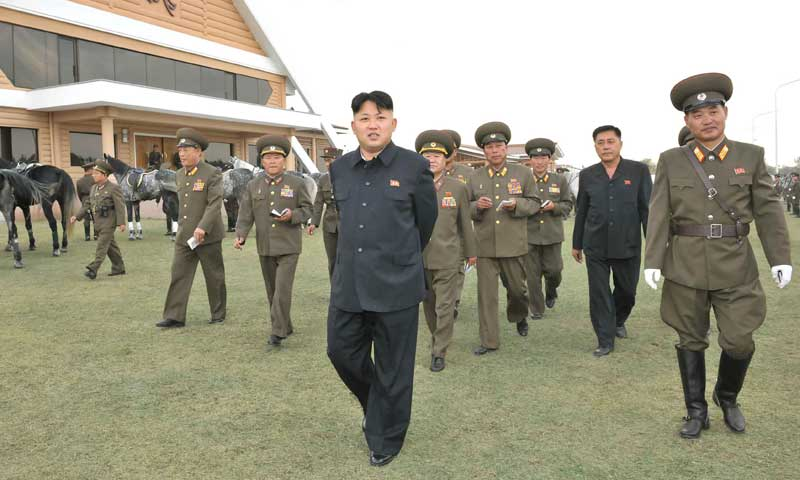 KCNA handout shows North Korean leader Kim Jong-un during a visit to